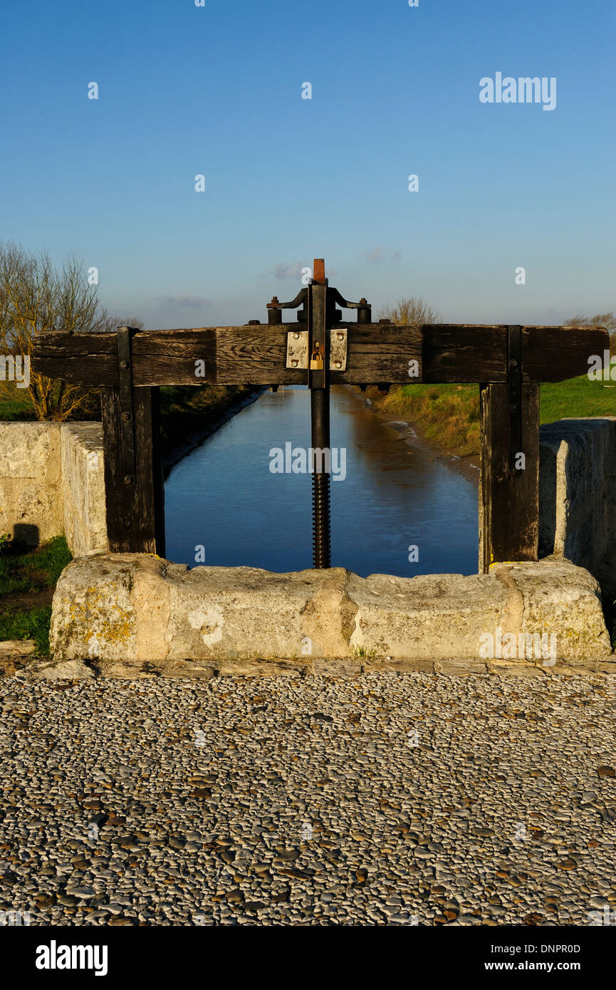Narrow channel containing water from the sea in Talmont sur Gironde in Charente-Maritime, France Stock Photo