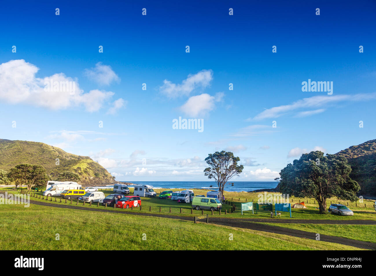Department of Conservation campsite at Tapotupotu Bay, Cape Reinga, Northland, New Zealand. These DOC... - Stock Image