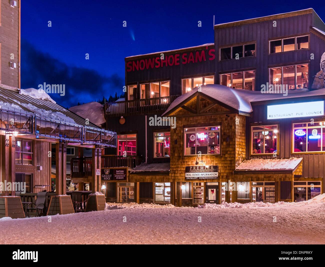 base village at night, winter, big white ski resort, british stock