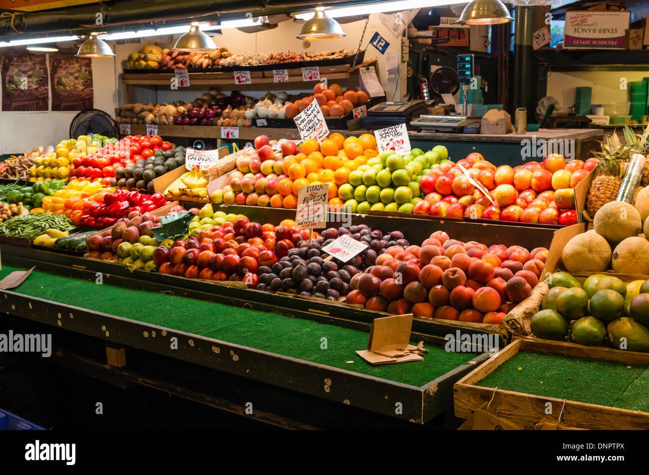 Fresh fruit on display at a produce vendor's market stall Pike Place Market Seattle, Washington, USA - Stock Image