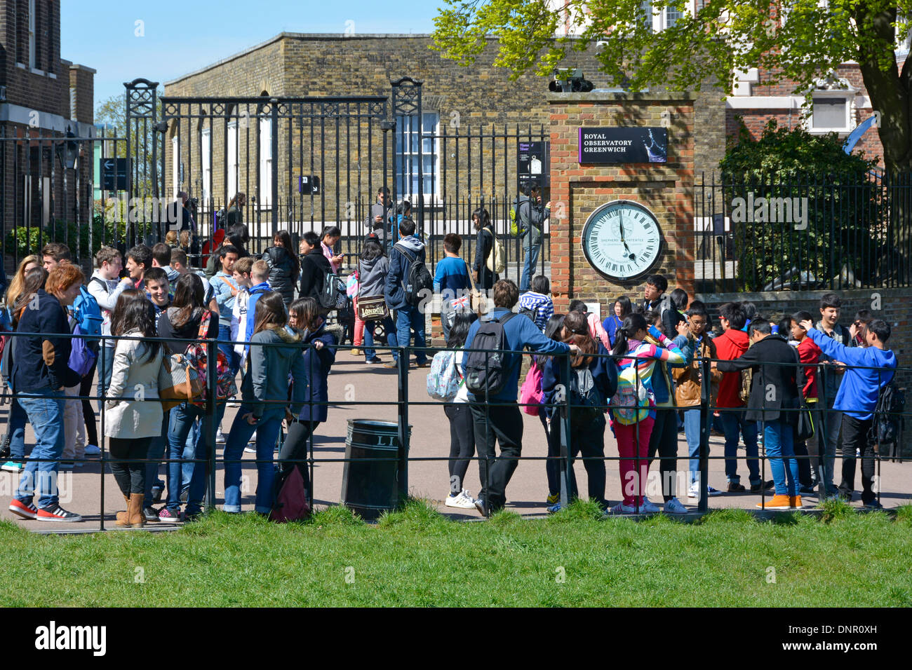 School children students some on trips from abroad on organised school college visits to the Royal Greenwich Observatory Greenwich London England UK - Stock Image