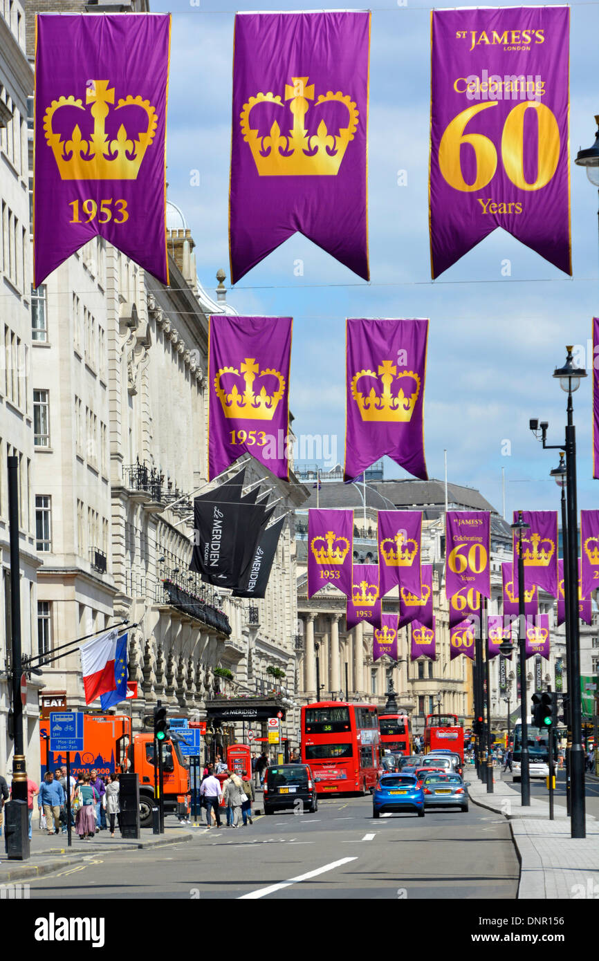Banners in London Piccadilly celebrating the Anniversary of Queen Elizabeths coronation (view towards Piccadilly Circus) - Stock Image