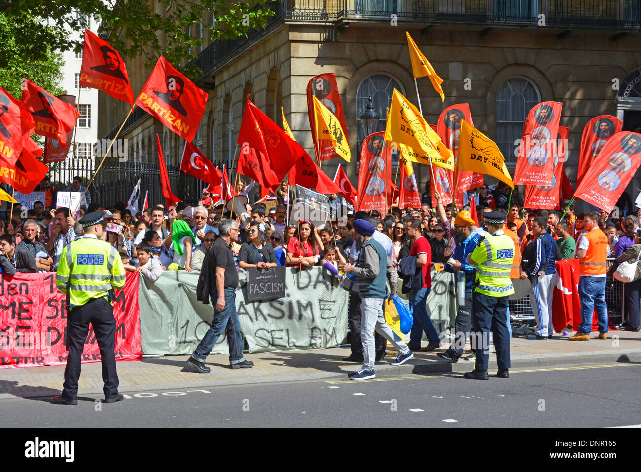 Turkish protest groups demonstrating in Whitehall opposite Downing Street - Stock Image