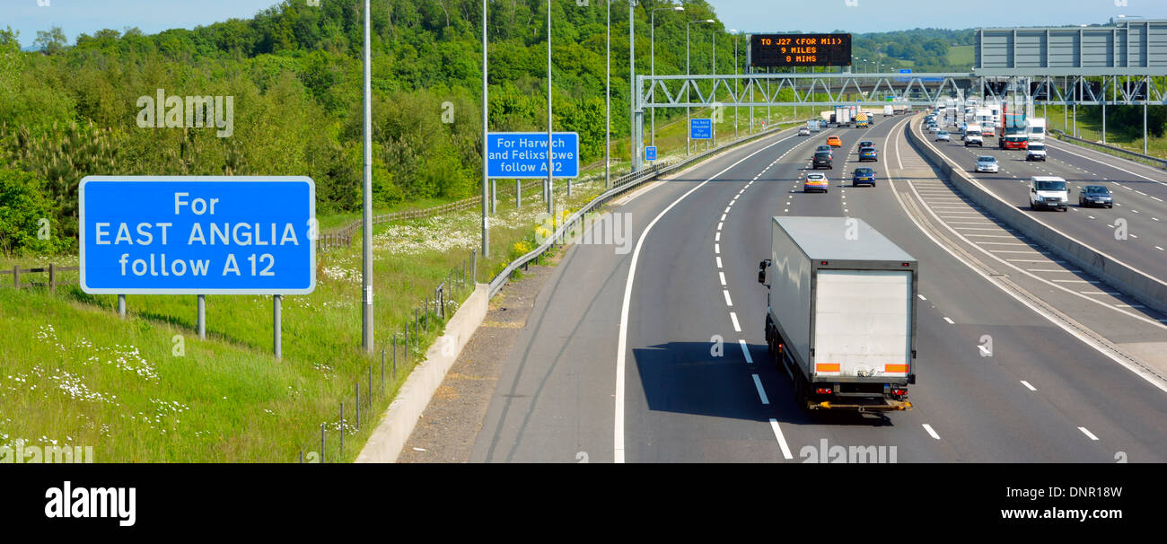 Assorted signs on M25 London Orbital motorway including gantry mounted electronic digital display Brentwood Brentwood Essex England UK - Stock Image