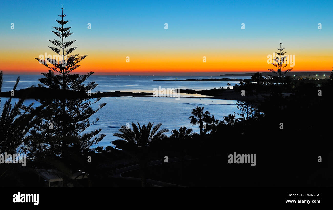 Sunset at the Nissi Beach in Ayia Napa, Cyprus. - Stock Image
