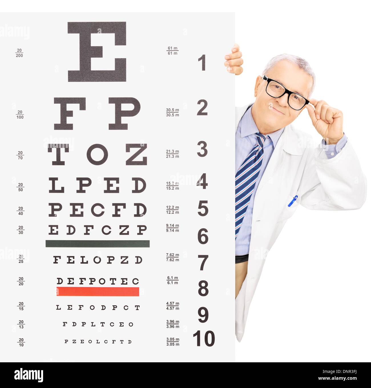 Male optician standing behind eyesight test - Stock Image