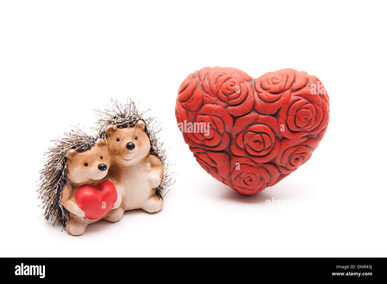 Red stone heart with hedgehog pair - Stock Image
