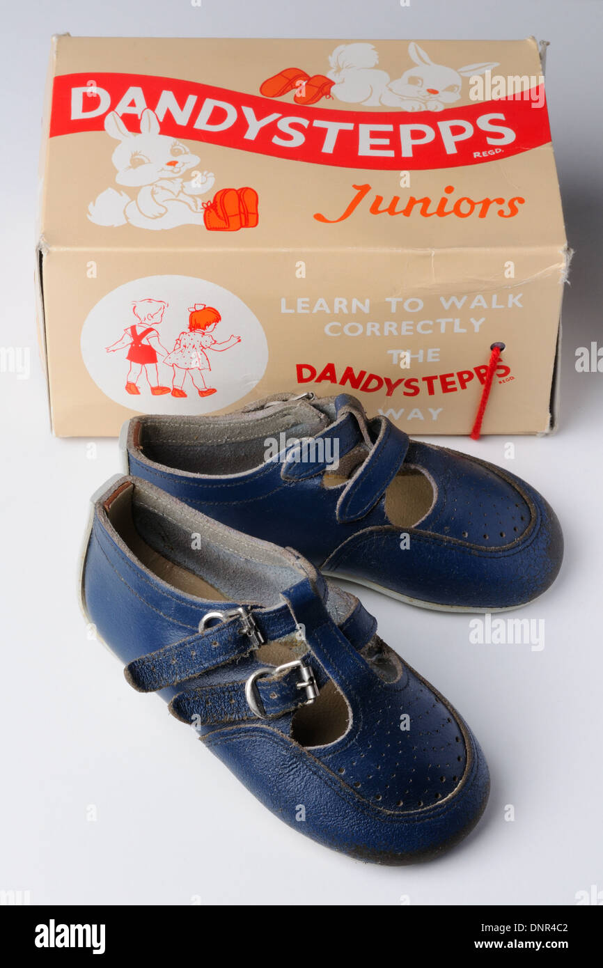 Worn infant shoes and Dandystepps shoe box. - Stock Image
