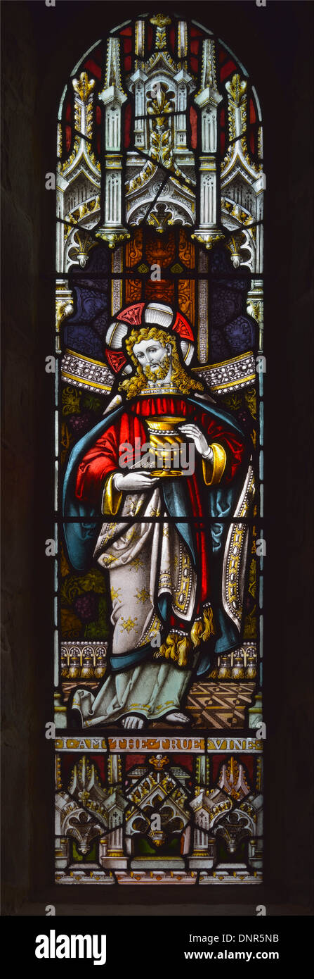 Christ with chalice. Window. Church of Saint Michael. Burgh-by-Sands, Cumbria, England, United Kingdom, Europe. - Stock Image