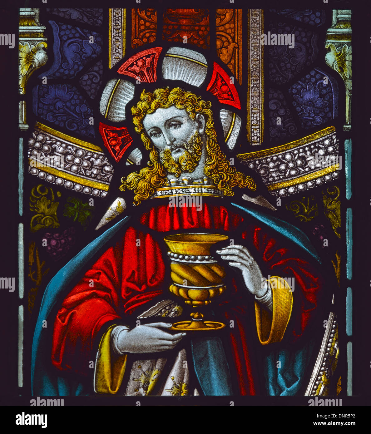 Christ with chalice. Detail of window. Church of Saint Michael. Burgh-by-Sands, Cumbria, England, United Kingdom, Europe. - Stock Image