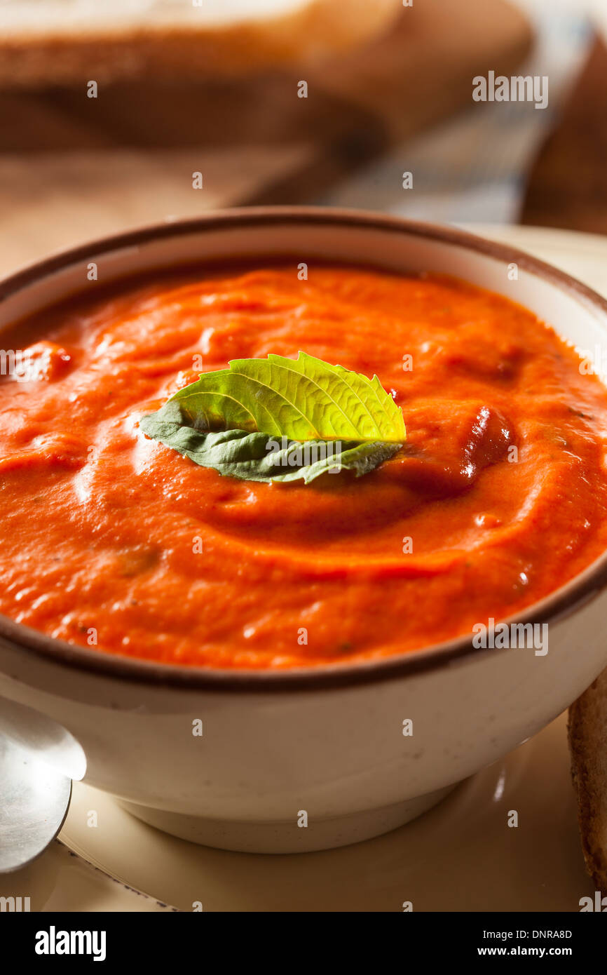 Creamy Tomato Basil Bisque Soup with Bread - Stock Image