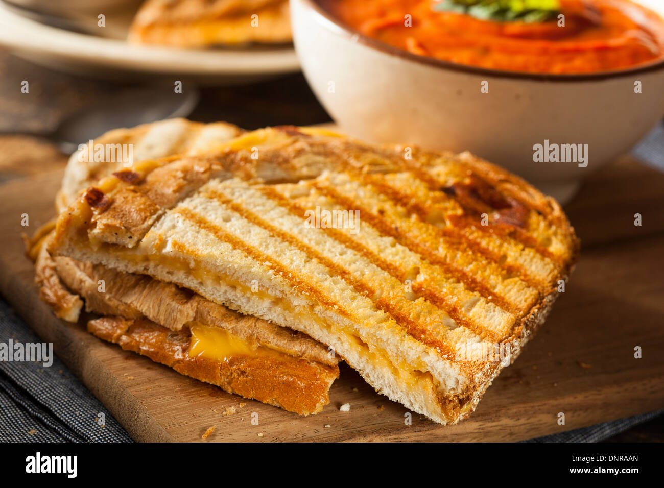 Grilled Cheese Sandwich with Creamy Tomato Basil Soup Stock Photo