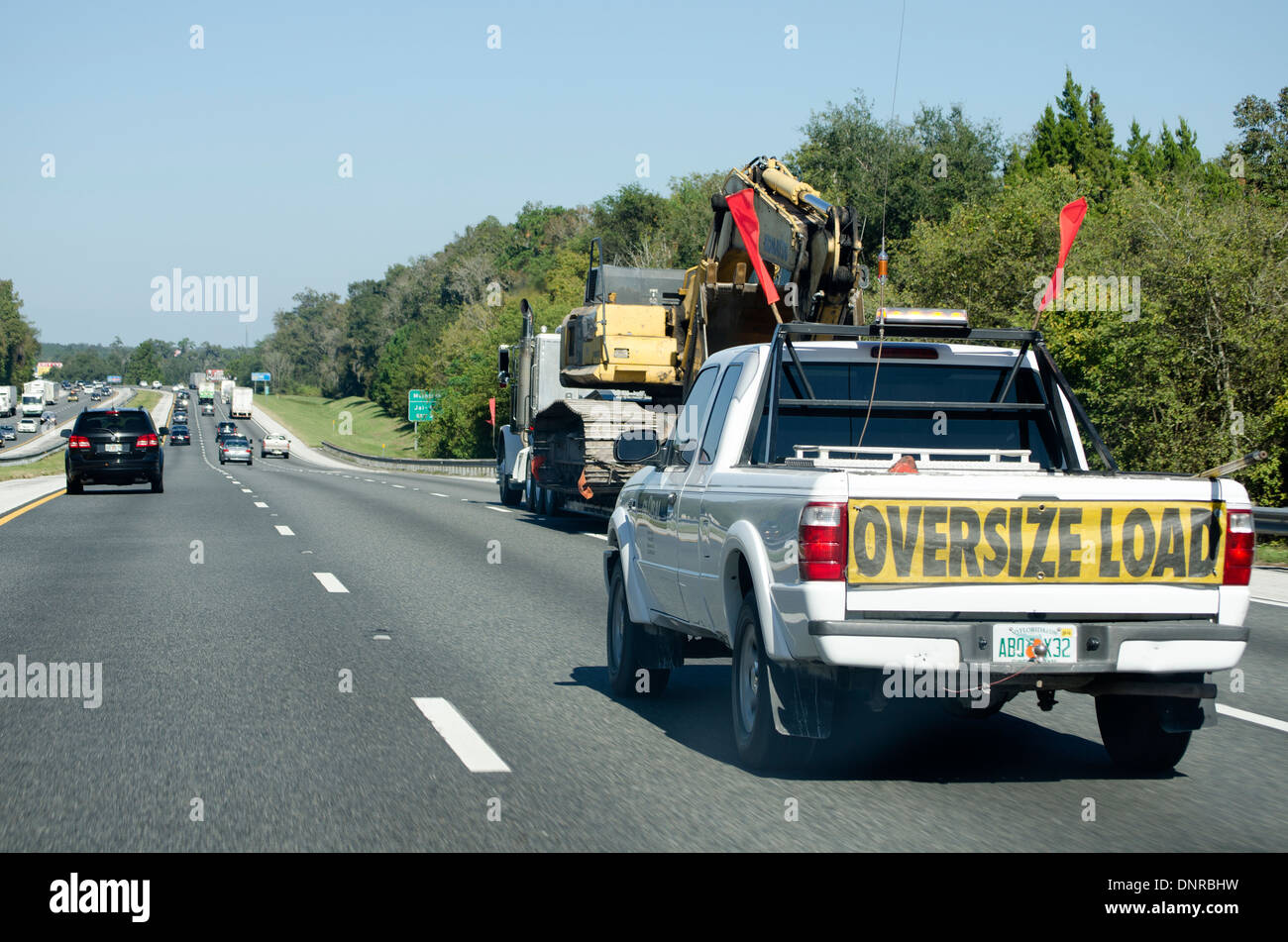 Escort vehicle truck with oversize load on I 75 highway America USA - Stock Image