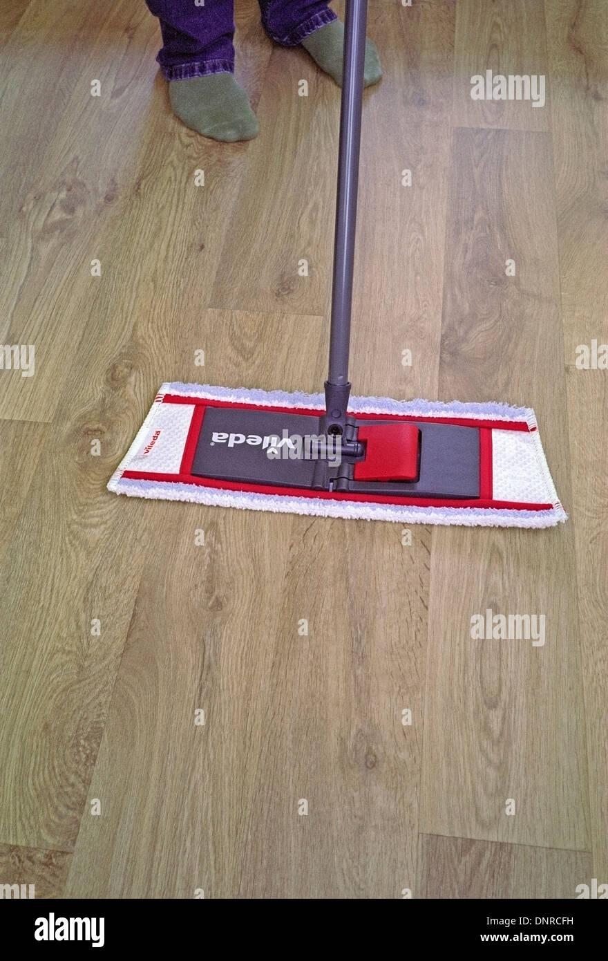 Man Using A Vileda Mop On Vinyl Wood Effect Floor UK MODEL RELEASED