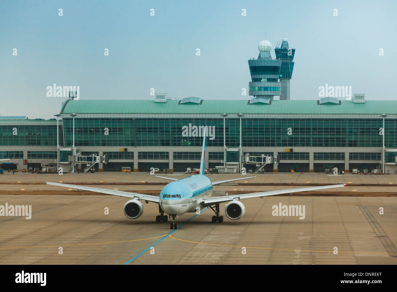 Korean Air Boeing 777-200 plane taxiing to runway - Incheon International Airport, South Korea - Stock Image