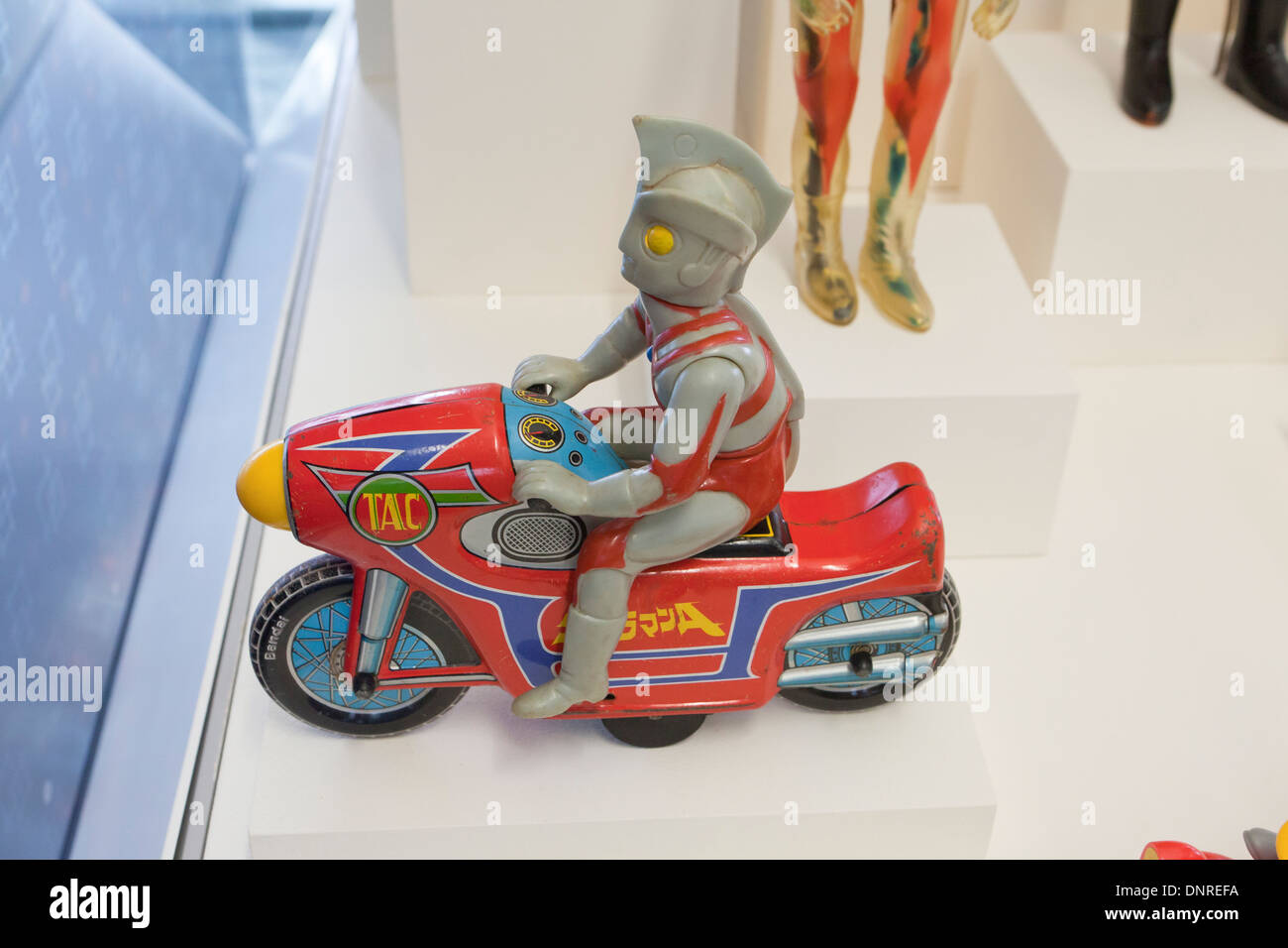 Friction-drive Ultraman Ace and Motorcycle Japanese toy, circa 1972 - Stock Image
