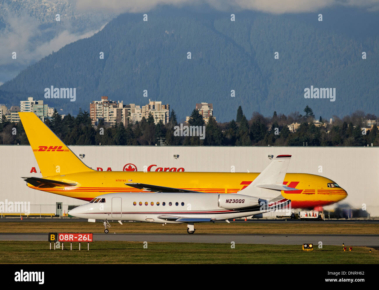 NetJets Dessault Falcon 2000EX EASy private executive business jet plane airplane landing lands Vancouver International Airport - Stock Image