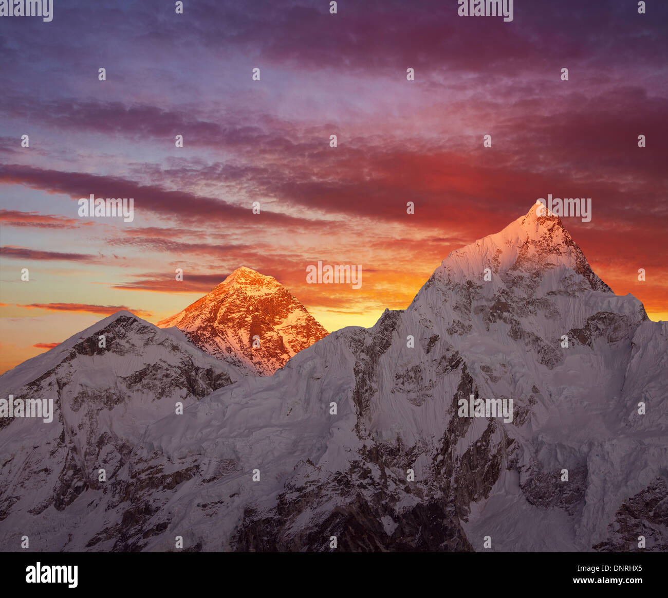 Greatness of nature. Golden pyramid of Mount Everest (8848 m) at sunset. - Stock Image