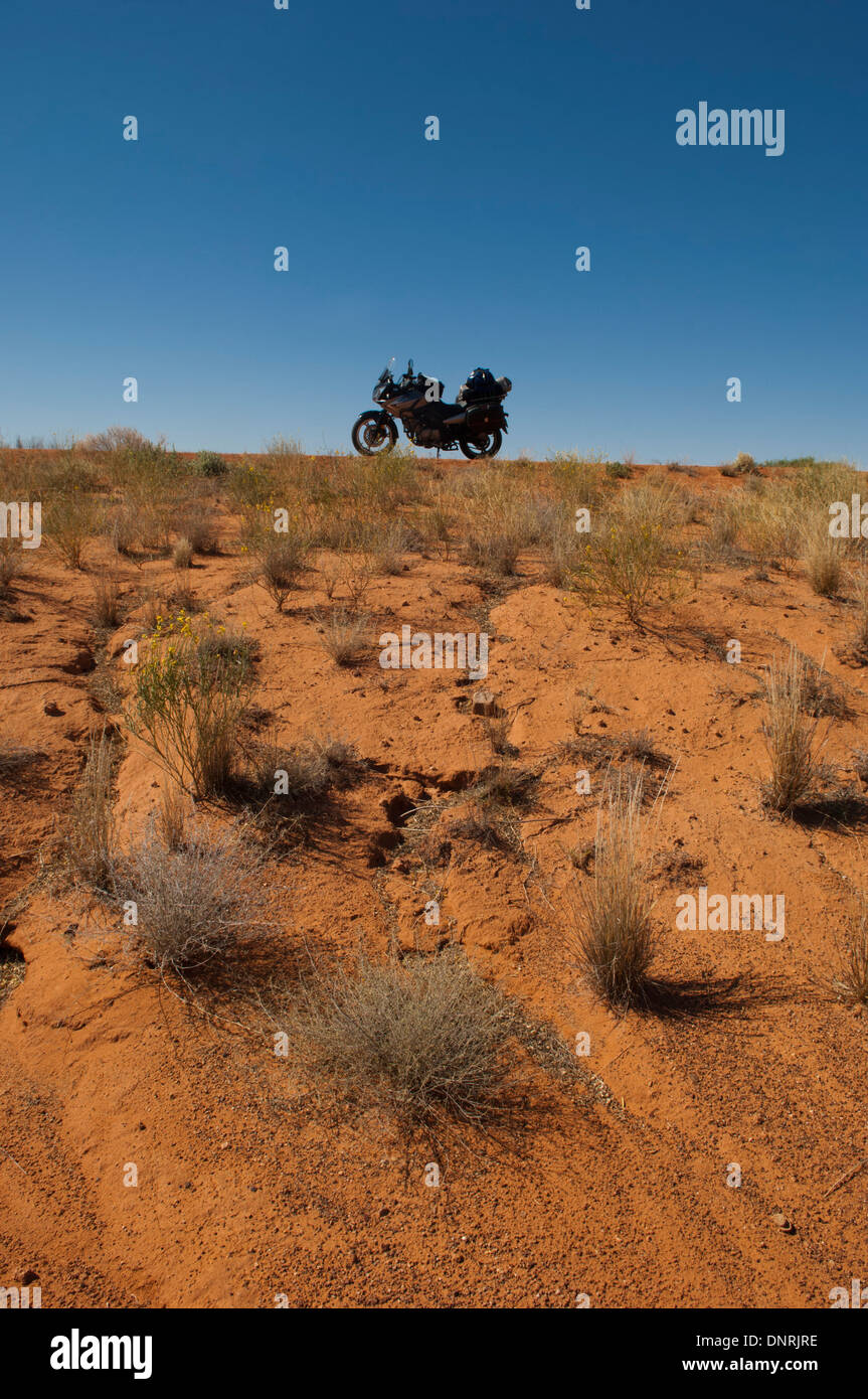 A motorcycle in the central Australian desert. - Stock Image