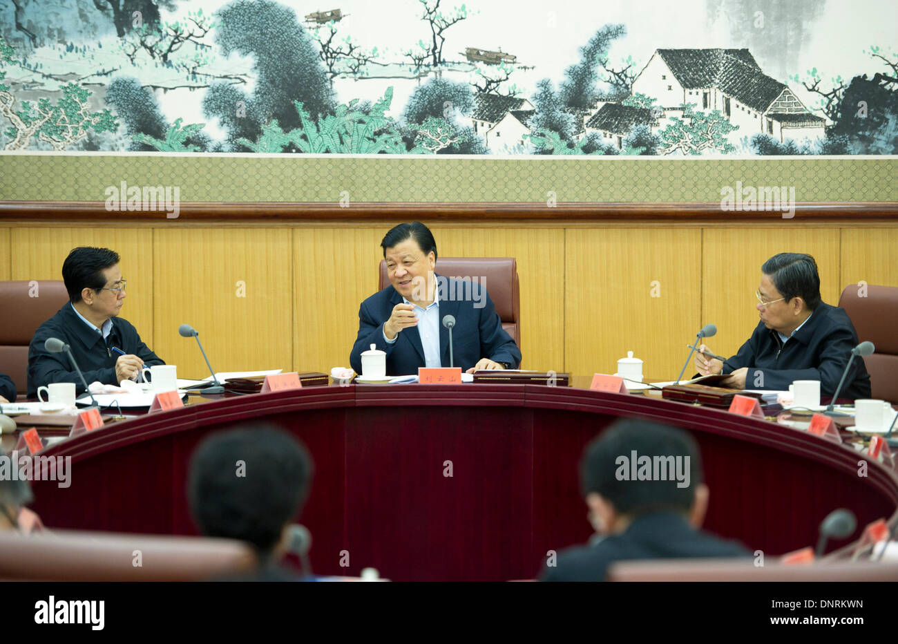 Beijing, China. 5th Jan, 2014. Liu Yunshan (C), a member of the Standing Committee of the Political Bureau of the Communist Party of China (CPC) Central Committee, presides over a meeting of the leading group of 'mass-line' campaign in Beijing, capital of China, Jan. 5, 2014. The one-year 'mass-line' campaign was launched in June last year to bridge gaps between CPC officials and members, and the general public, while cleaning up undesirable work styles such as formalism, bureaucracy, hedonism and extravagance. © Xie Huanchi/Xinhua/Alamy Live News - Stock Image