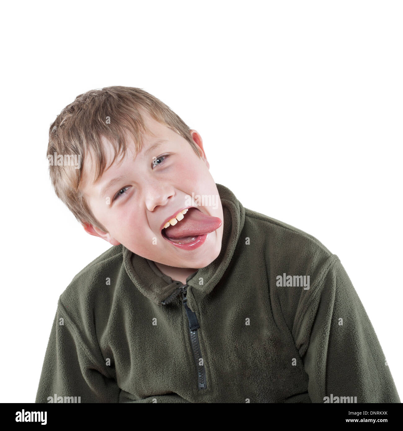 A 10 year old boy sticking his tongue out in the Uk Stock Photo