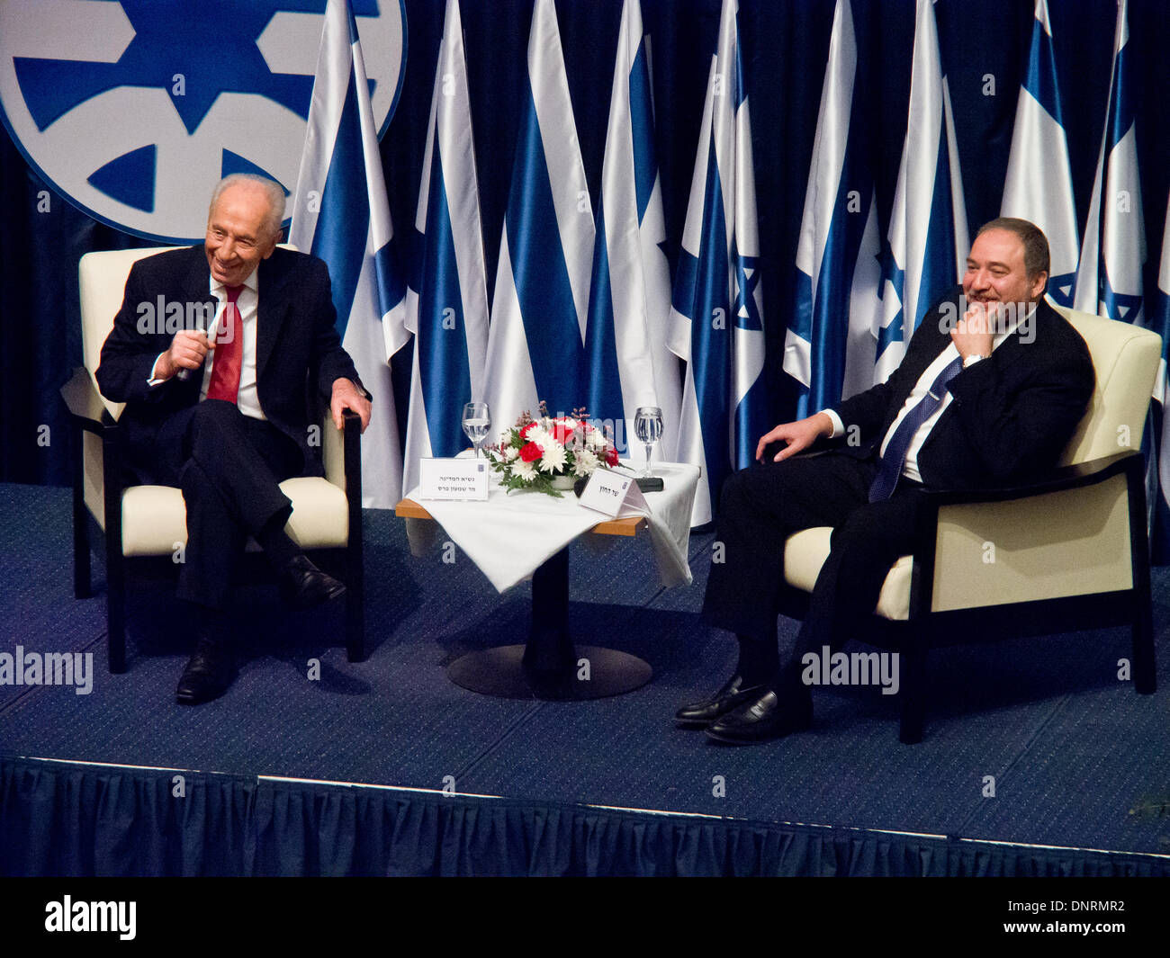 Jerusalem, Israel. 5th Jan, 2014. President of the State of Israel, Shimon Peres (L), addresses diplomats, seated besides FM Avigdor Lieberman (R) at the Ministry of Foreign Affairs. Jerusalem, Israel. 5-Jan-2014.  President Peres opened the Ambassadors Conference for heads of Israeli diplomatic missions worldwide alongside Foreign Minister Lieberman at the Ministry of Foreign Affairs. Credit:  Nir Alon/Alamy Live News - Stock Image