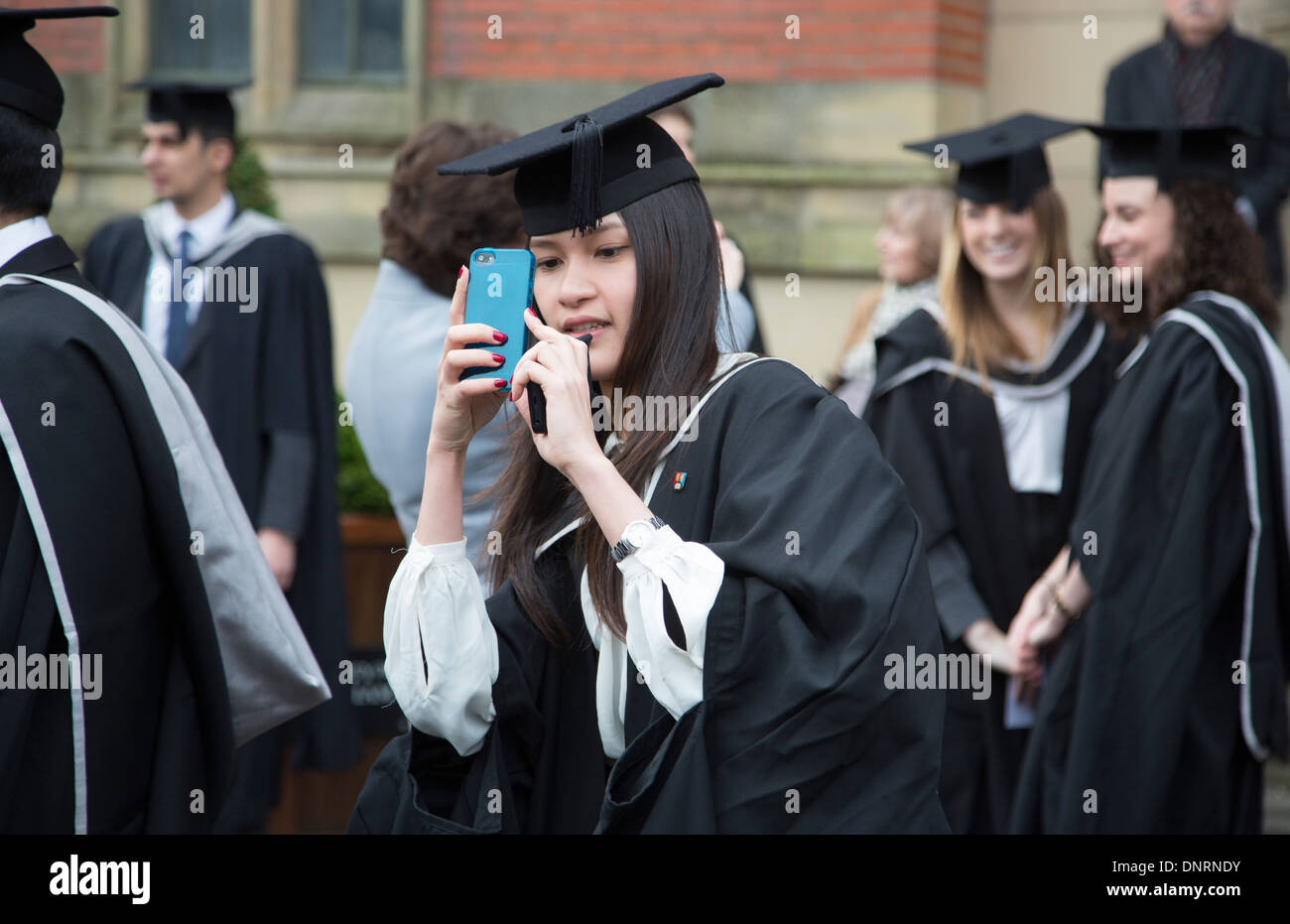 Happy students after their graduation ceremony at University of Birmingham, UK. - Stock Image