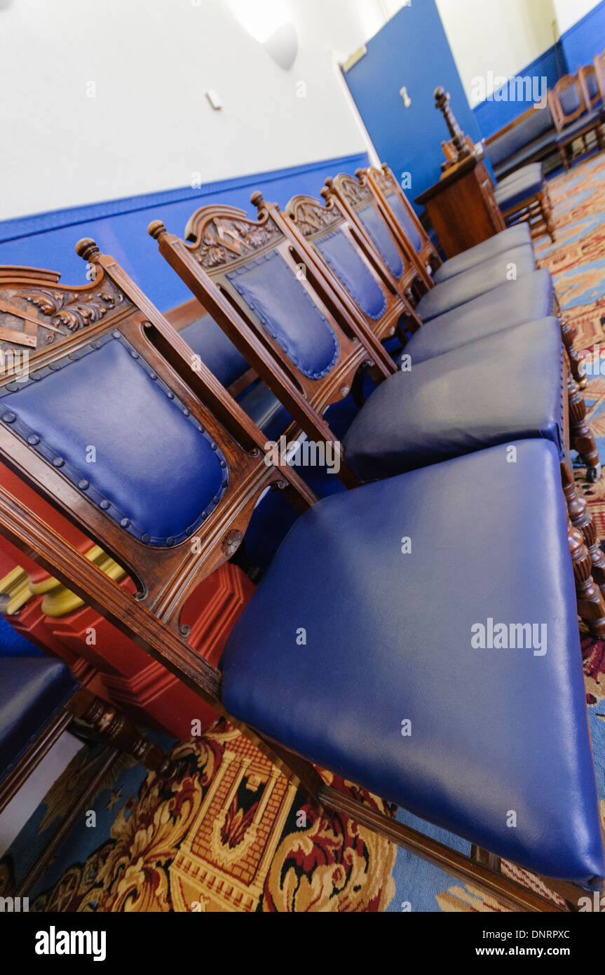 Row of blue chairs in a Masonic lodge room - Stock Image