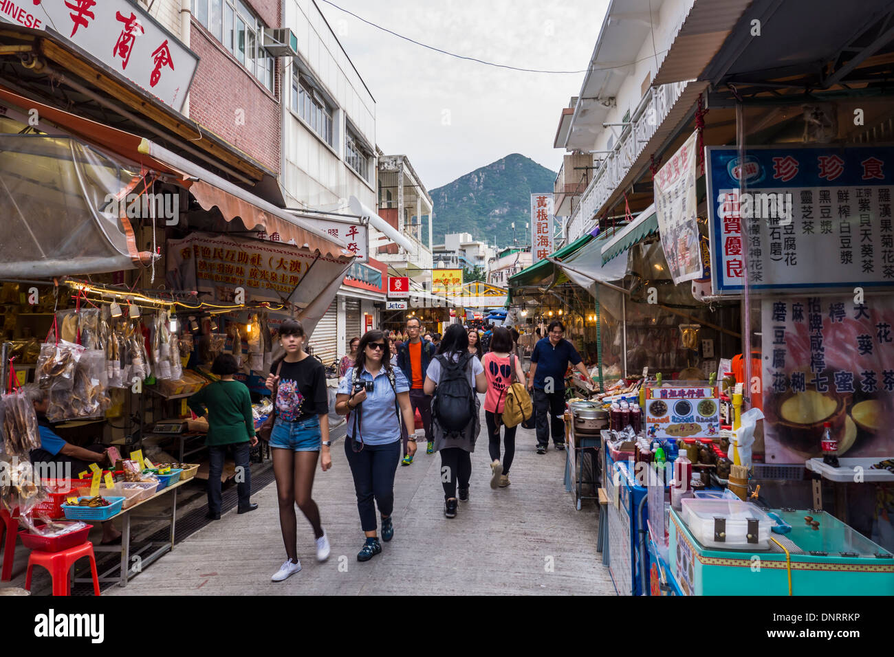 Street Lined with Foot Stalls and Restaurants in the Tai O Fishing village,  Lantau Island, Hong Kong, China - Stock Image