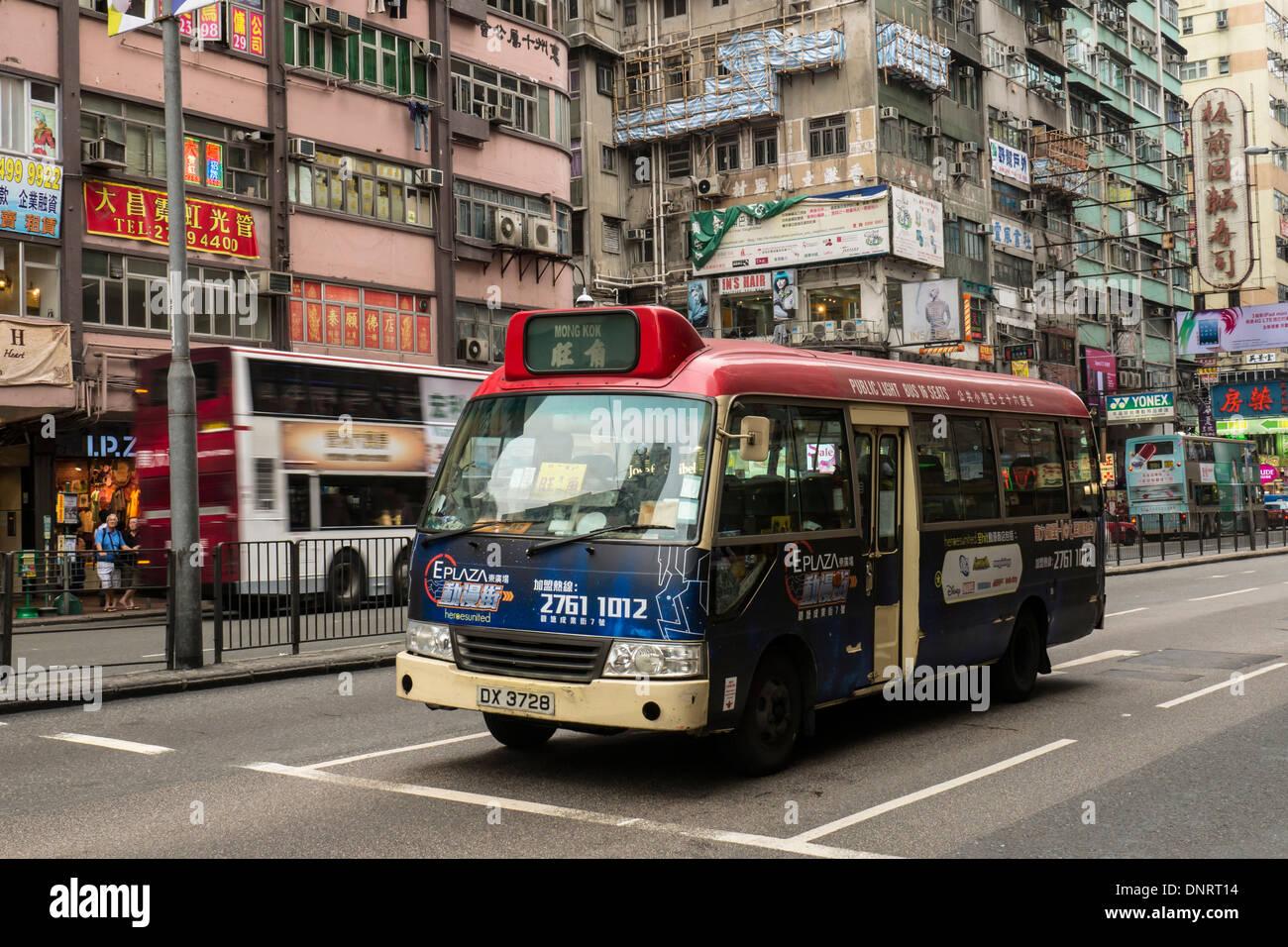 Minibus Running on the Street of Kowloon, Hong Kong, China - Stock Image
