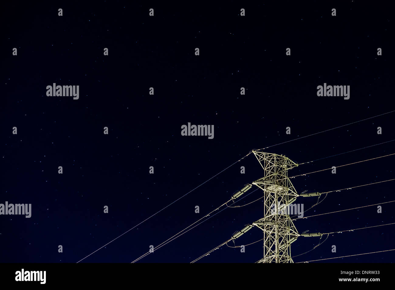 Telegraph Pole with Dark Sky in the backgroud - Stock Image
