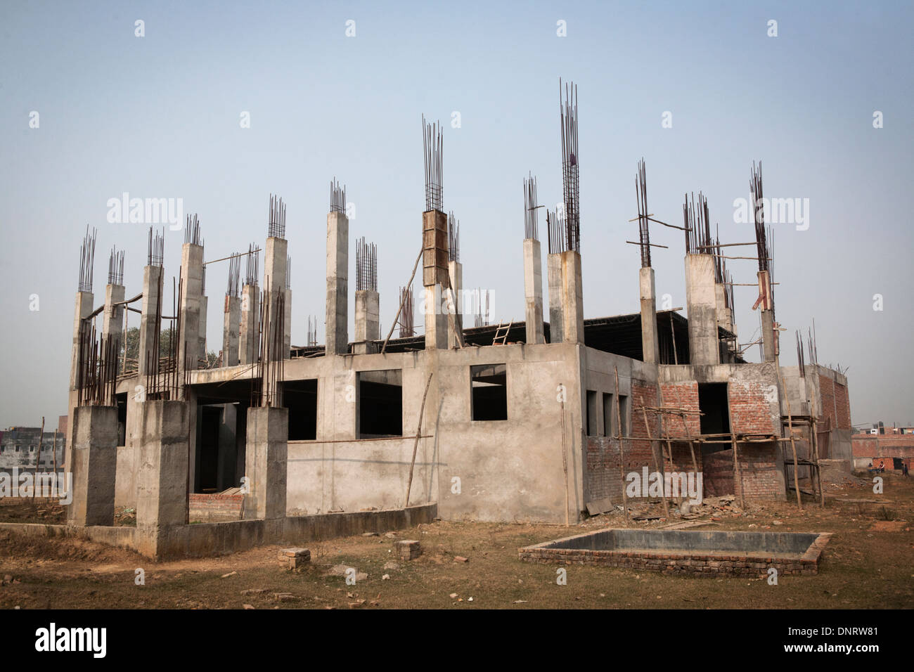 An unfinished but seemingly abandoned building in Sarnath, Uttar Pradesh, India. - Stock Image