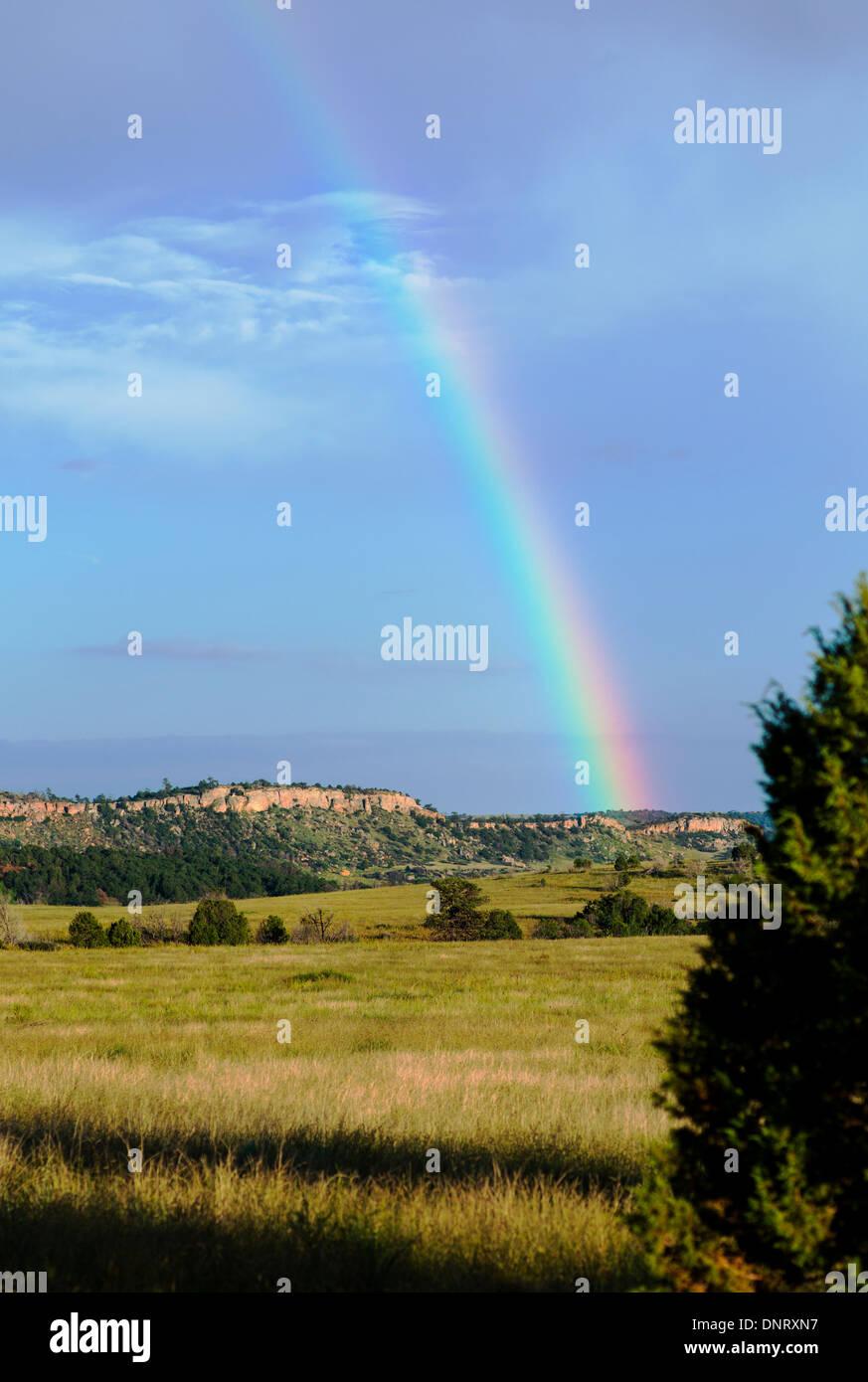 Rainbow over fields south of Colorado Springs, Colorado, USA - Stock Image