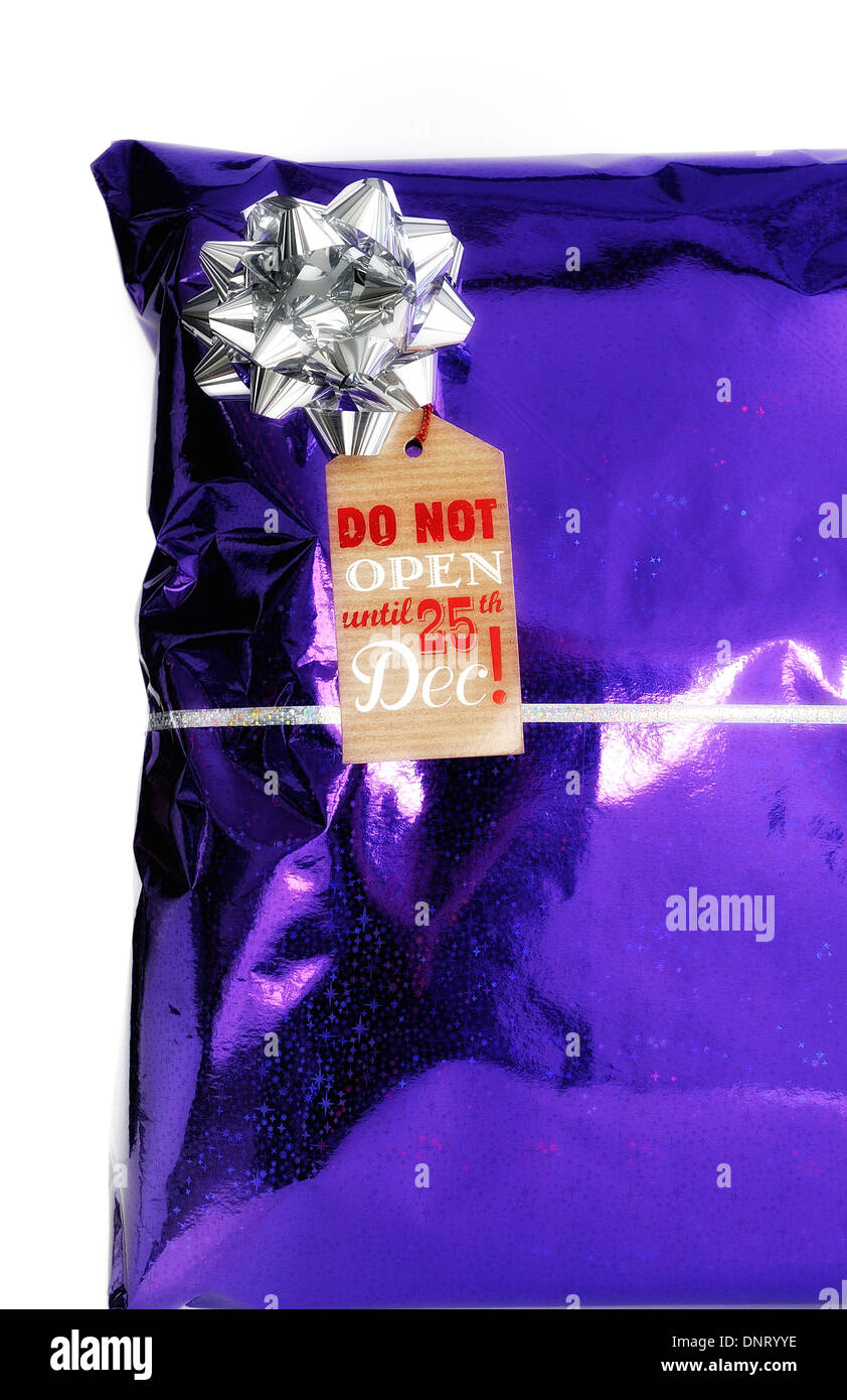 Christmas present with tag saying do not open until 25th December - Stock Image
