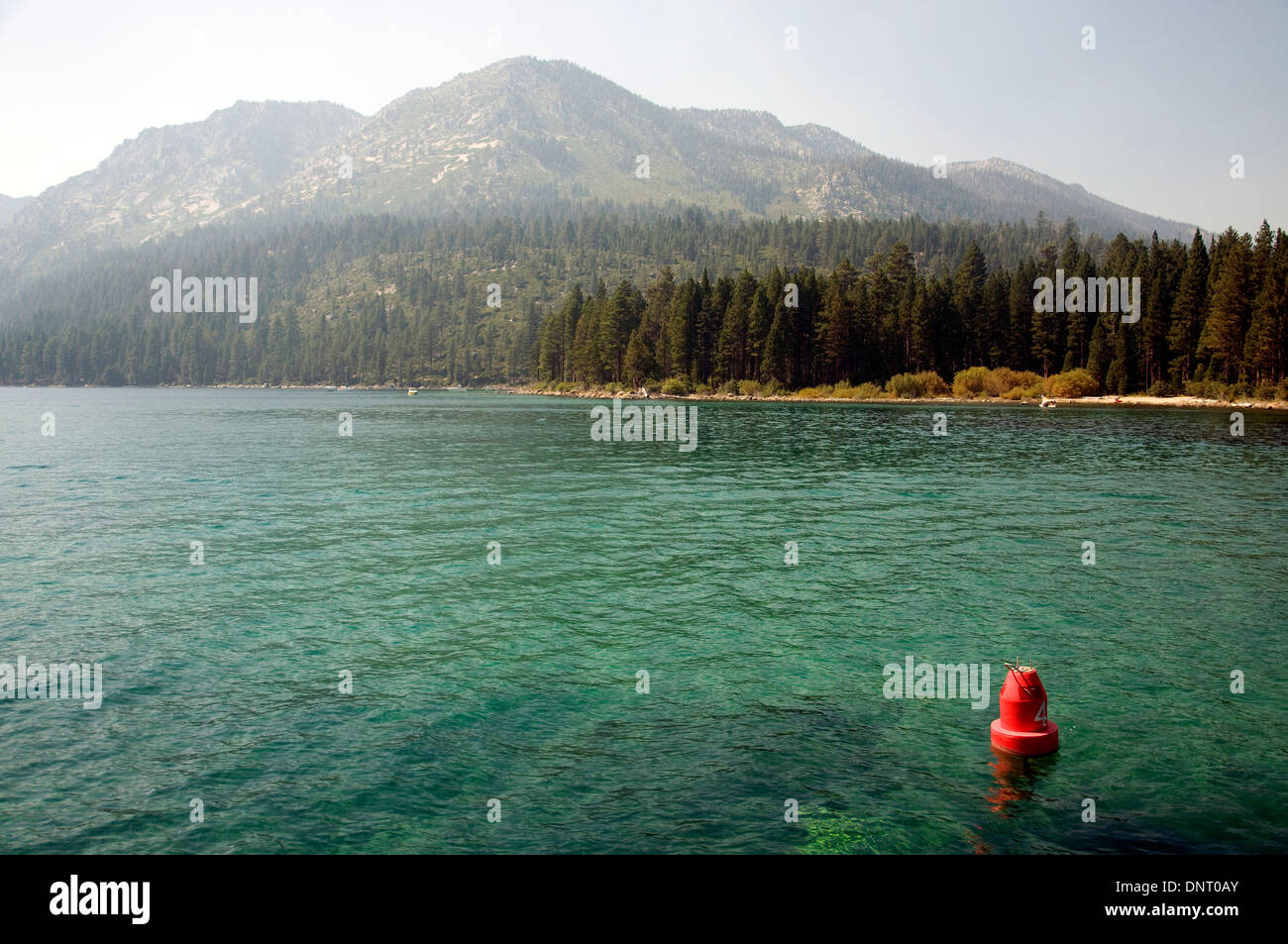 Emerald Bay, a shallow area in the south of crystal-clear Lake Tahoe, marked by a red buoy - Stock Image