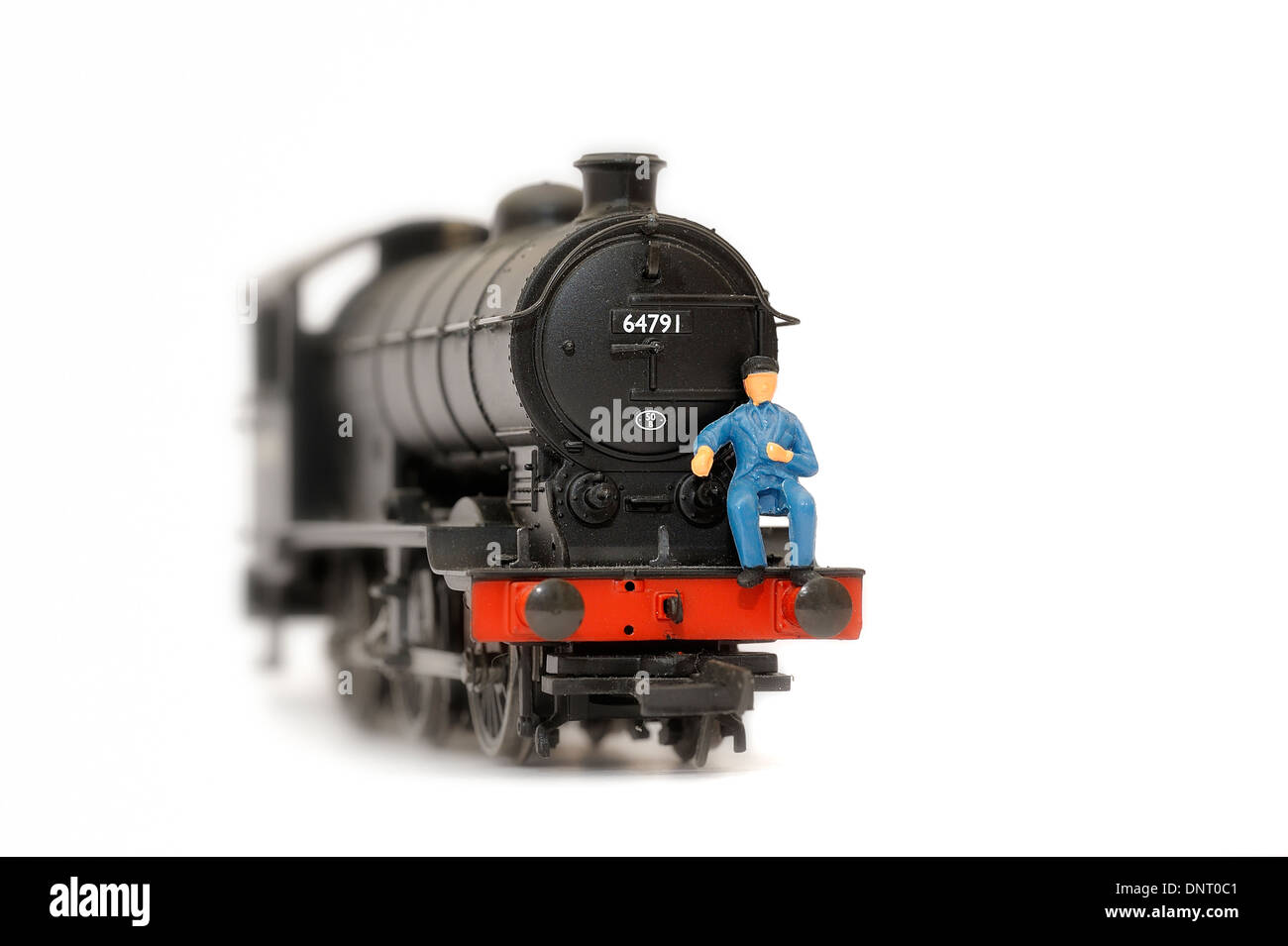 Scale Model of an old steam locomotive J39 CLASS 64791 with driver sitting on the front Stock Photo