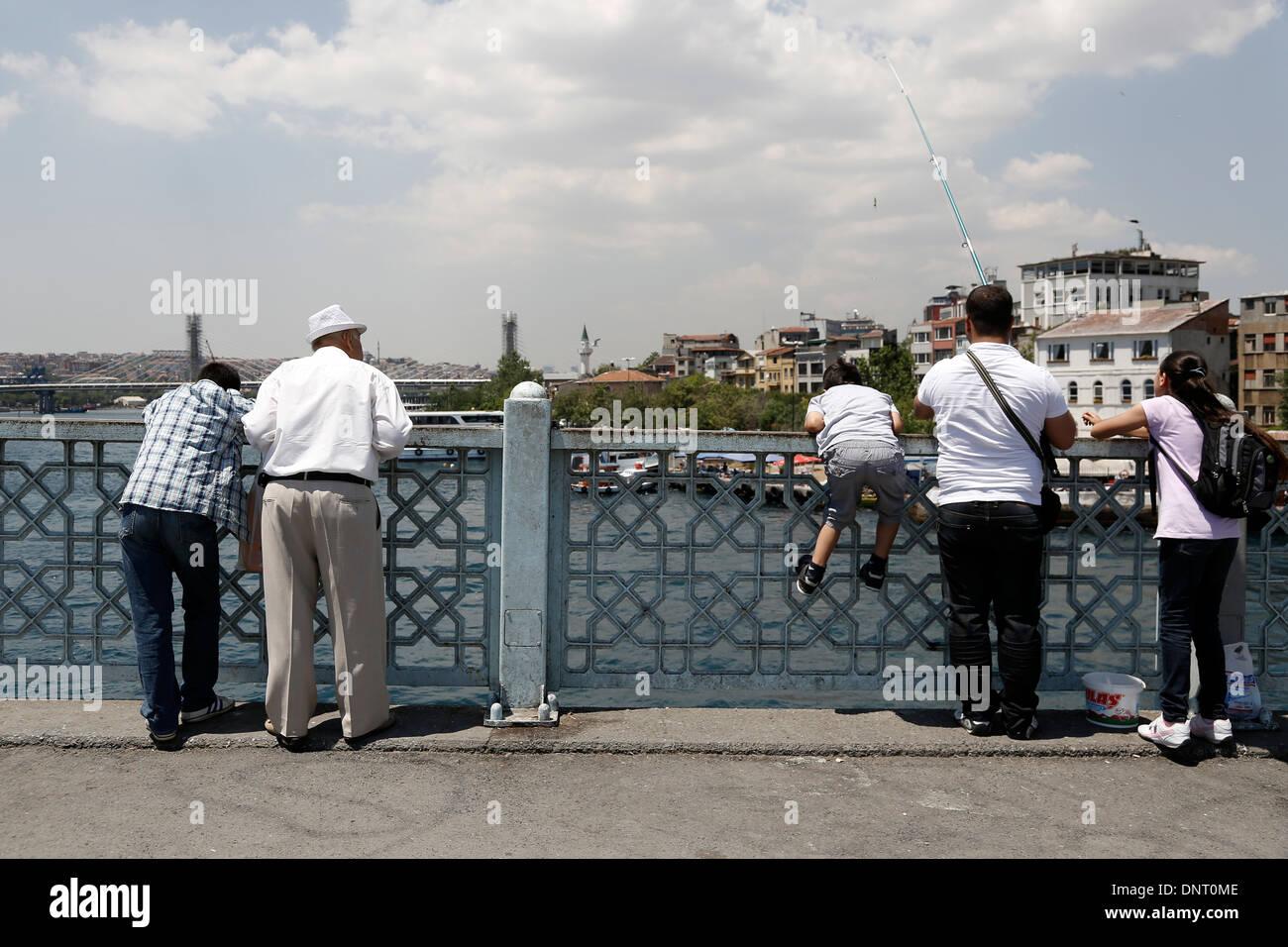 Istanbul Galata Bosporus fisher tourists - Stock Image