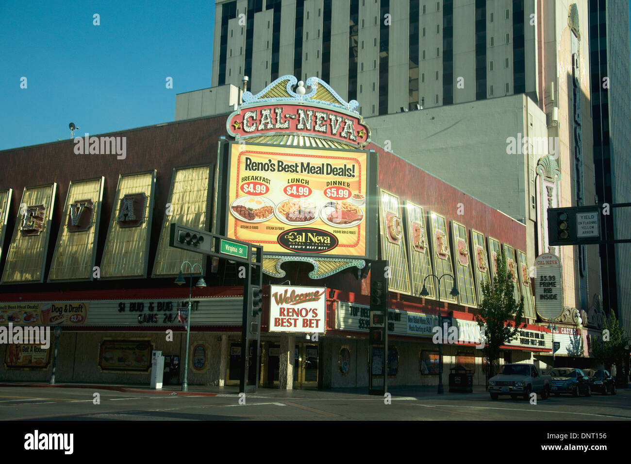 In Reno, Nevada, a casino promotes cheap food and gambling to out-of-season empty streets at dusk - Stock Image