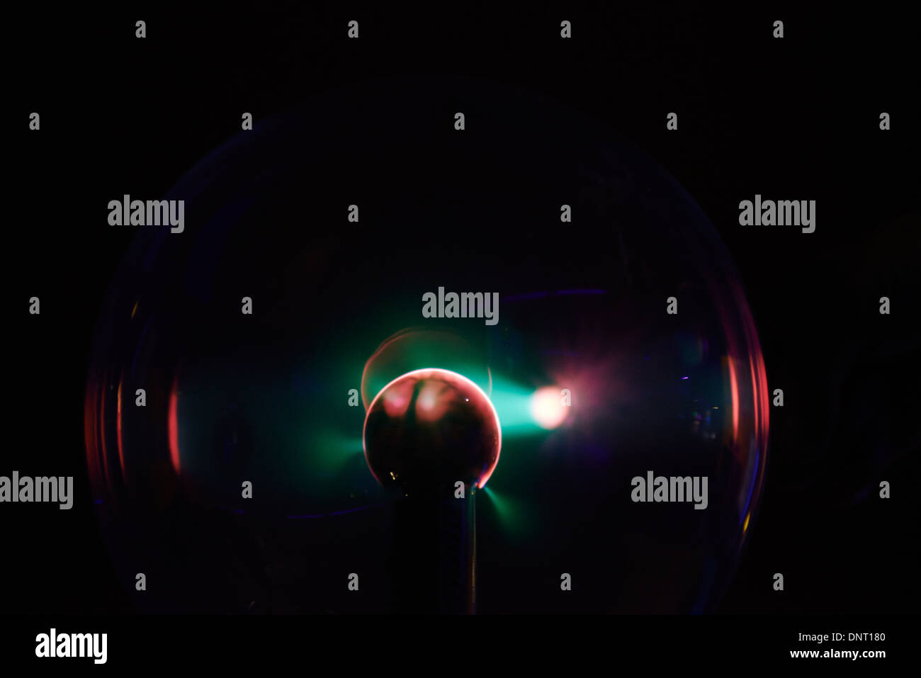 Electricity Arcs from a Plasma Ball - Globe - Lamp when finger touch it - Stock Image