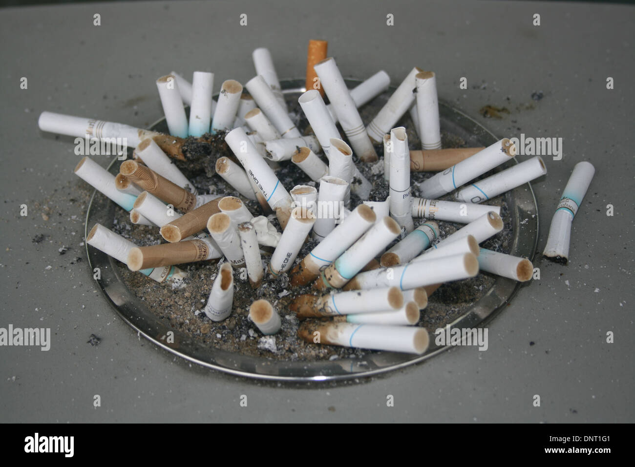 Cigarette butts outside Radisson Hotel, Los Angeles, USA - Stock Image
