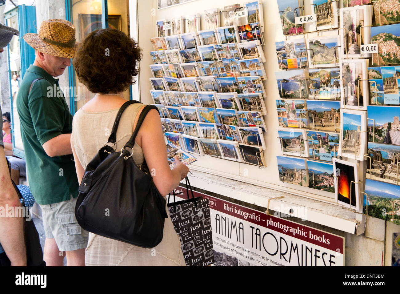 Tourists buying postcards in Taormina, Sicily - Stock Image