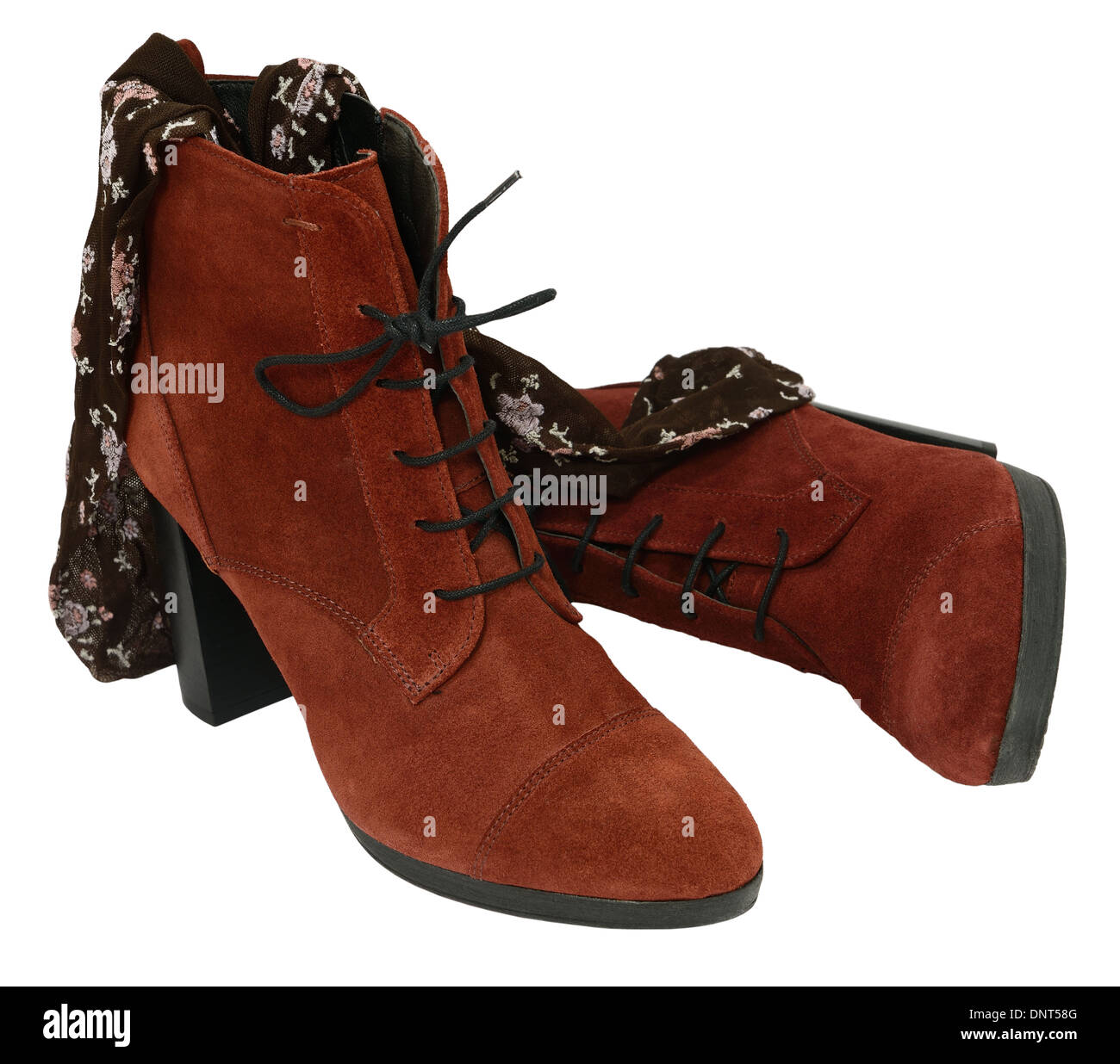 Female suede leather boots with tights isolated on white. - Stock Image