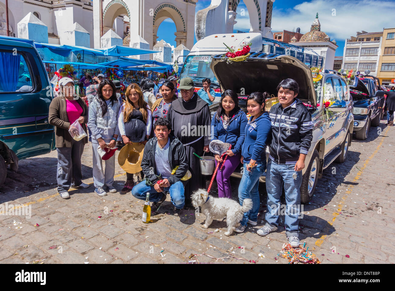 A large family grouping, at the blessing of the automobiles in front of the Basilica of Our Lady of Copacabana, Bolivia. - Stock Image