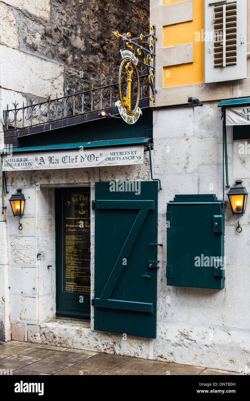 Front entry to a small locksmith in the Old Town of Geneva, Switzerland - Stock Image