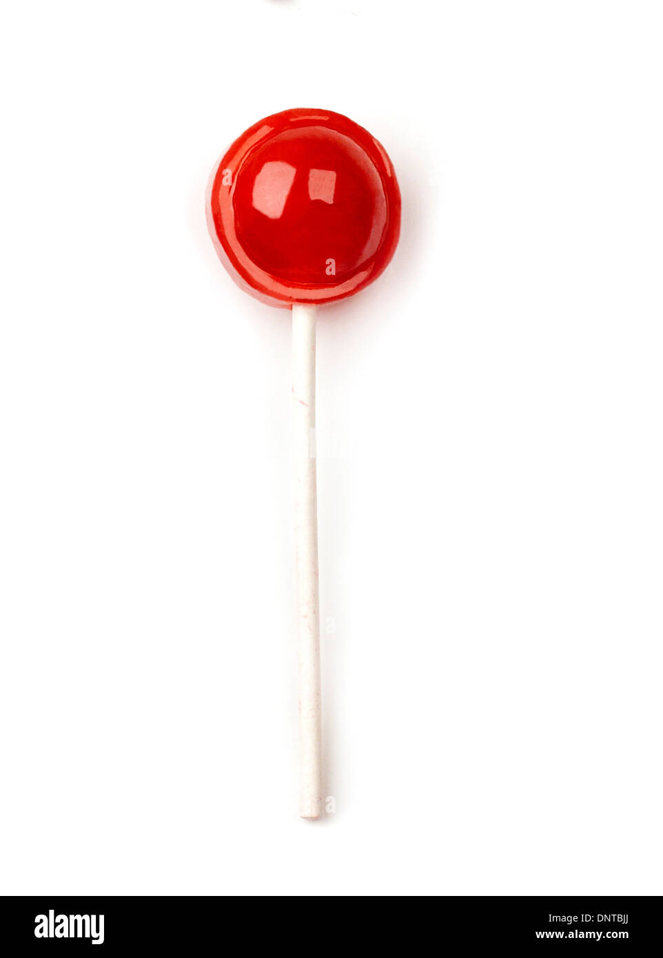Single unwrapped tootsie roll pop - Stock Image