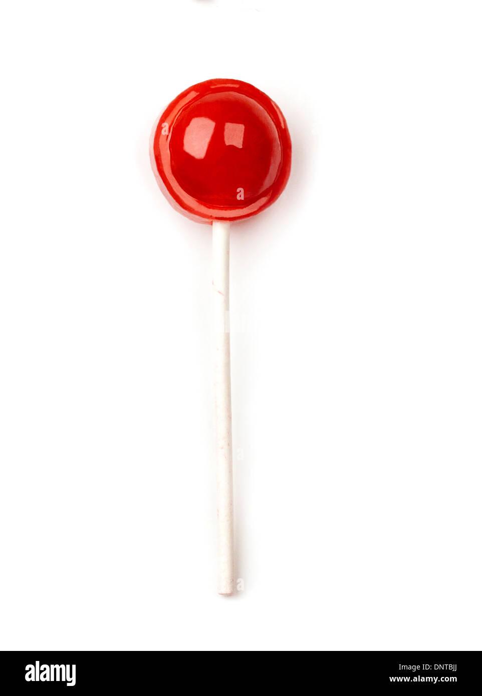 Single unwrapped tootsie roll pop - Stock Image