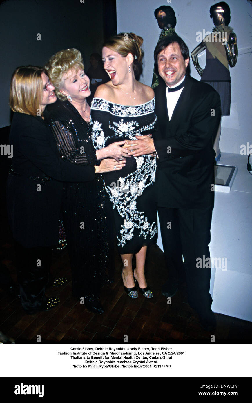 Feb. 24, 2001 - Carrie Fisher, Debbie Reynolds, Joely Fisher, Todd Fisher.Fashion Institute of Design & Merchandising, Los Angeles, CA 2/24/2001.Thalians to Benefit for Mental Health Center, Cedars-Sinai.Debbie Reynolds received Crystal Award. Milan Ryba/   2001 K21177MR(Credit Image: © Globe Photos/ZUMAPRESS.com) - Stock Image