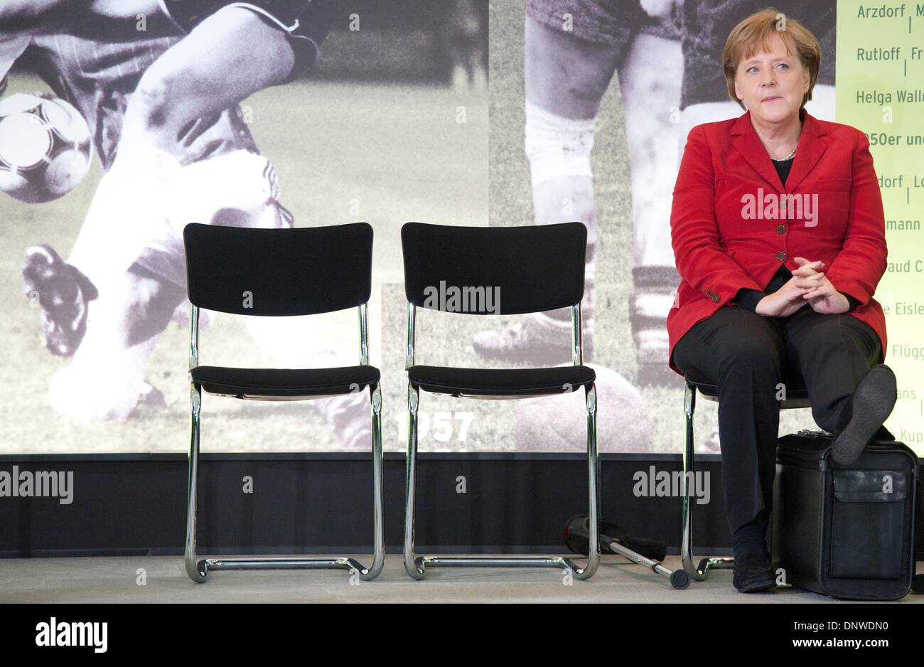(FILE) The file picture dated 05 April 2011 shows German Chancellor Angela Merkel (CDU) who put up her leg onto a suitcase in front of a photo wall in the German Chancellery in Berlin, Germany. Photo: Tobias Kleinschmidt/dpa - Stock Image