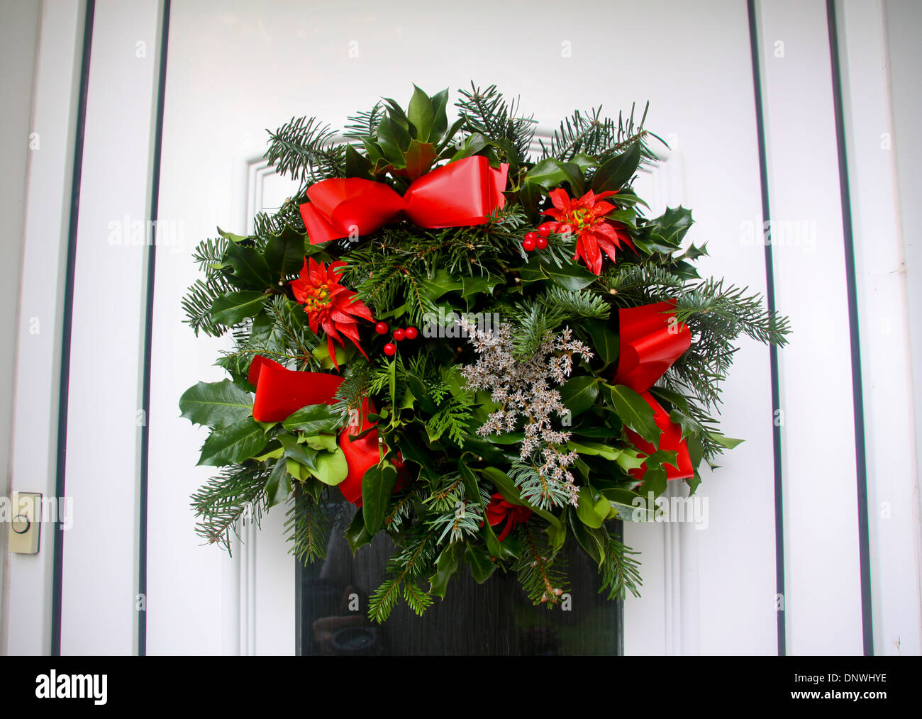Christmas holly wreath on uPVC front door - Stock Image