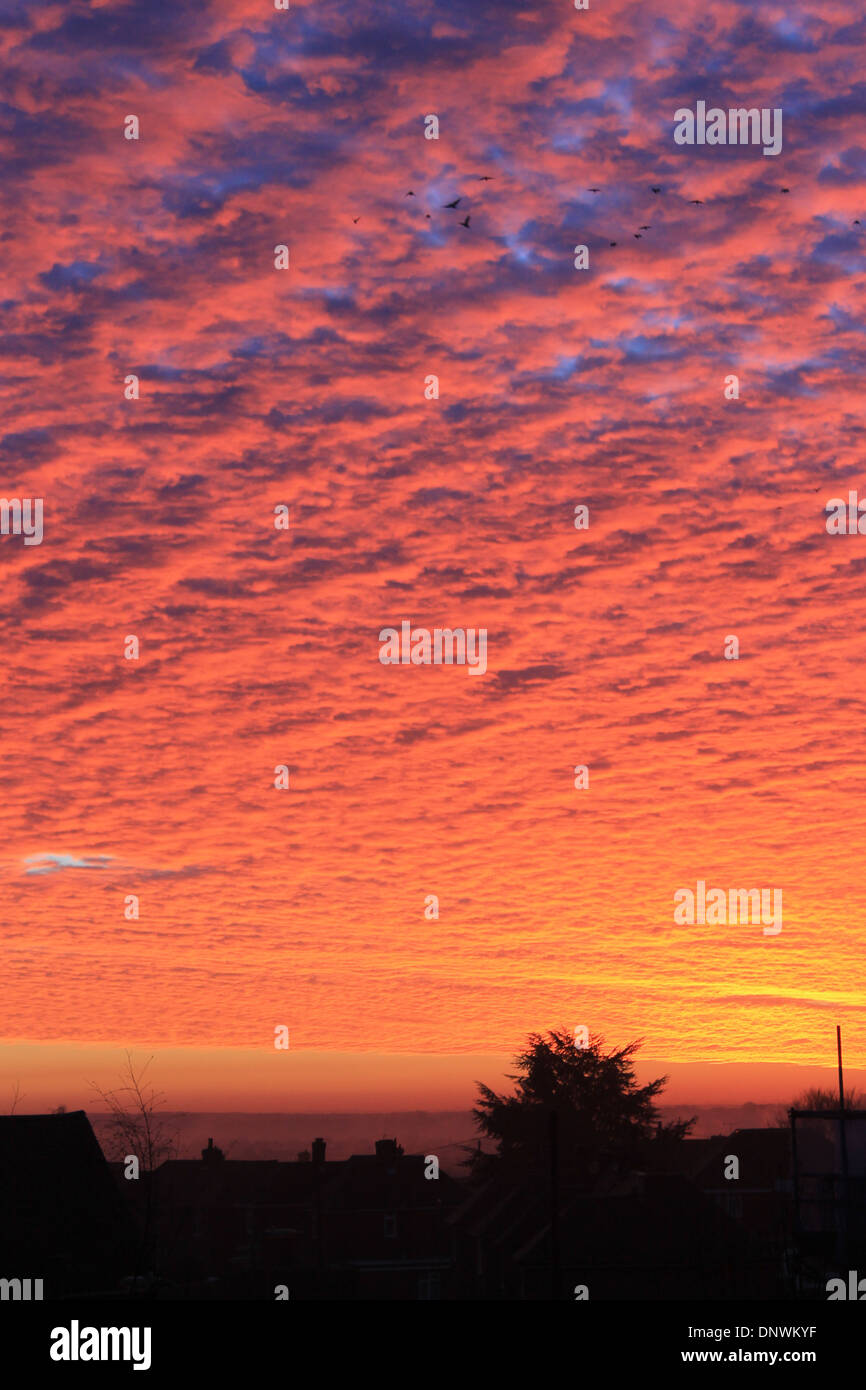 Amazing red sky at sun rise on a winter's morning over Eastleigh, Hampshire, UK - Stock Image